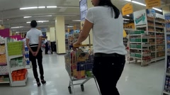 Woman pushing cart in a shopping mall Stock Footage