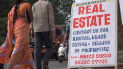 Real estate agent advertising billboard on streets of Bangalore in India Stock Footage