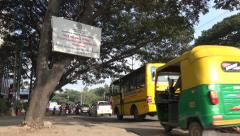Busy traffic and warning sign in Bangalore India Stock Footage