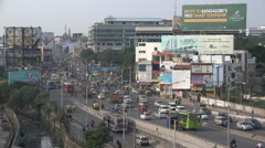 Bangalore, India, busy rush hour traffic, advertising billboards, skyline Stock Footage