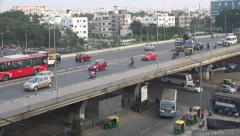 Traffic drives over an elevated highway in Bangalore, India Stock Footage