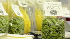Packages of dried pasta on the table Stock Footage