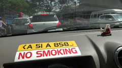 Bangalore traffic jam, inside the taxi, no smoking sign, India Stock Footage