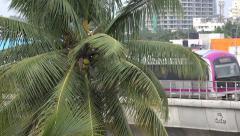 India, Bangalore, metro line, palm tree, transportation, infrastructure Stock Footage