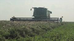 Cylinder mower machine cutting grass in field Stock Footage