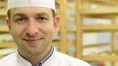 Chef smiles to camera - closeup Stock Footage