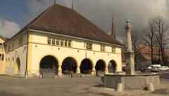 SWITZERLAND Môtier historic hotel and fountain in village Stock Footage