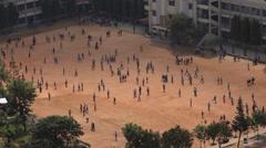 India Bangalore education school students playground break Stock Footage