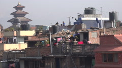 Nepal, Bhaktapur, daily scene, rooftop buildings, temple complex Stock Footage