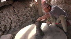 Artist uses traditional method to create ceramic pottery in Bhaktapur Nepal Stock Footage