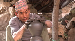 Asian artist creates beautiful ceramic pottery in classic Nepali village Stock Footage