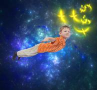 Young boy flying with abstract background - stock photo