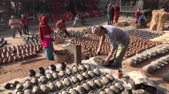 Kneading clay at Potters' Square in Bhaktapur, Nepal Stock Footage