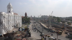 Central Chennai, India, construction site, traffic, colonial style buildings - stock footage