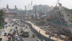 India Chennai construction site railway station transport traffic cranes - stock footage