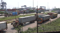 India, Chennai Port, cargo trucks at the container terminal Stock Footage