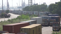 India, Chennai Port, cargo trucks are lined up at the container terminal - stock footage