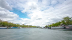 Paris. The excursion motor ship floats down the river Seine in the cloudy spring Stock Footage
