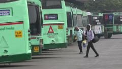 India, Chennai, buses at the Mofussil Bus Terminus Stock Footage