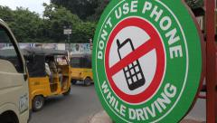 India, road safety, traffic sign, mobile phone, forbidden, warning Stock Footage