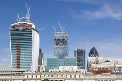 View over the Thames River in London to the city with several new skyscrapers - stock photo