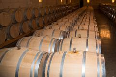 Wine cellar with barrels in stacks Stock Photos