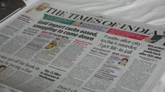 India newspaper, journalism, Times, press freedom, flipping pages - stock footage