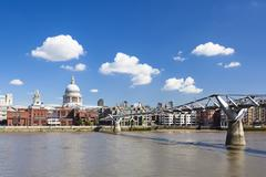 Millennium Bridge in London with St. Paul's Cathedral in the background and a - stock photo
