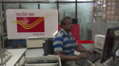 Post office, sending a parcel, checking the address, India Stock Footage