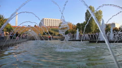 The fountain on the waterfront on sunny day Stock Footage