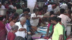 India, bustling fish market busy crowds looking for bargain trade - stock footage