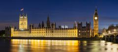 Panoramic long exposure night shot of the Houses of Parliament in London with Stock Photos