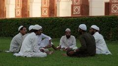 Stock Video Footage of India, Delhi, young Muslim men have gathered at the courtyard of Humayun