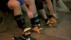 Athletes wear shoes for sporting events - stock footage