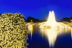 The famous Europaplatz fountain in Aachen, Germany at night with a bush of be - stock photo