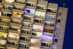 Detail shot of a tall illuminated apartment building at Europaplatz in Aachen Stock Photos