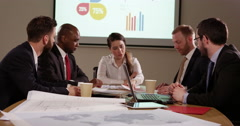 A confident businesswoman presenting a financial report to her team. In slow mot Stock Footage