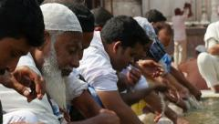 India, New Delhi, Muslim men washing in mosque before Friday prayer Stock Footage