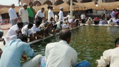 Muslim men prepare for Friday prayer in New Delhi mosque Stock Footage