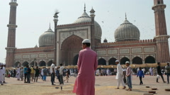 People visit the Friday mosque in New Delhi, India - stock footage