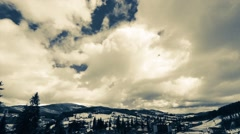 Clouds moving over the top of the mountain. Timelapse Stock Footage