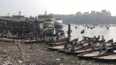 Dhaka Bangladesh, Buriganga river, boatmen attract passengers, commuters Stock Footage