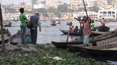 Dhaka, Bangladesh, boatmen wait for passengers crossing the river Stock Footage