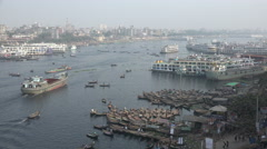 Dhaka skyline, busy Buriganga river, activity, boats, ferries, cargo vessels Stock Footage