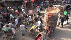 Dhaka, busy street, cycle rickshaws, pedestrians, cargo transport, Bangladesh Stock Footage