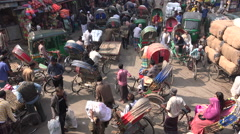 Rickshaw riders in busy square and bazaar in Dhaka, Bangladesh - stock footage