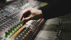 Working on a audio mixing console, sound mixer Stock Footage