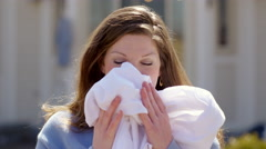 Woman smells clean laundry and smiles to camera 4K - stock footage