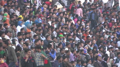 Crowds of football fans watch soccer match in Dhaka, Bangladesh Arkistovideo