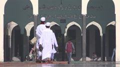 Dhaka, Bangladesh, Muslim men and boys walk towards the mosque Stock Footage